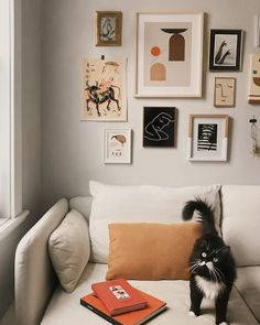 gallery wall in the sitting room of the relaxed, beige tinted apartment of Audrey Rivet.