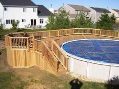 Above Ground Pool Decking Options | This pool deck wraps half way around the circular swimming pool.