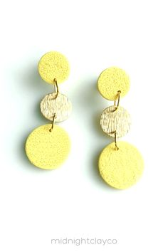 Textured polymer clay earrings. Tiered circle dangle earrings with gold brass connectors. Fun, colorful dangle earrings make the perfect accessory for a spring or summer outfit. Give as a unique birthday gift for coworker, client, or daughter. Makes a great graduation gift! Shop these trendy handmade earrings for women in my etsy shop! Unique Earrings, Women's Earrings, Earrings Handmade, Statement Jewelry, Gold Jewelry, How To Clean Earrings, Birthday Gifts For Sister, Yellow Earrings, Unique Gifts For Her