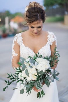 Bouquet made of hydrangea, peonies and white roses with greenery.