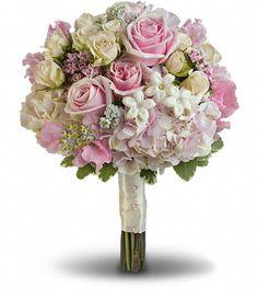 pink hydrangea, light pink roses, crème roses, pink sweet pea, pink bouvardia, stephanotis and dusty miller