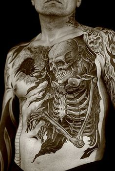 Skeleton chest tattoo