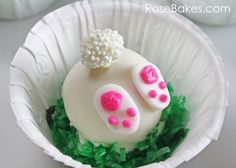 These little cake balls use the same recipe as your standard cake pop. Rose at Rose Bakes covered them in white chocolate and tops them with fondant feet and a white nonpareil's sprinkled tails.