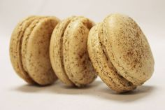 Gingerbread & Eggnog French Macarons by TC Paris: Our ginger and cinnamon dusted macaron shells, filled with real eggnog buttercream and our homeade crushed gingerbread cookies.