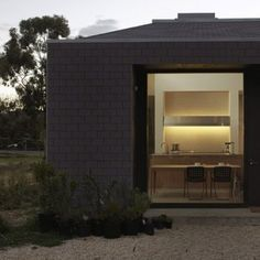 Goldfields Dwelling by DesignOffice - concrete, glass, white oak inside; asphalt shingles without. Minimalist Interior, Minimalist Home, Australian Homes, Prefab Homes, Industrial House, Dezeen, Architect Design, Beautiful Buildings, Interior And Exterior