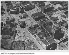 """An aerial view of downtown Rochester, looking south from East Avenue. This view shows the area of McCurdy's department store before the construction of Midtown Plaza.""""Downtown Rochester before Midtown Plaza #2 McCurdys corner E. main and Elm St""""."""