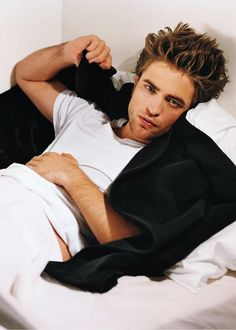rob pattinson. i don't always think he looks cute.....but he looks h-o-t in this pic.