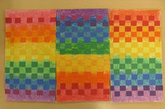 Paper Weaving Roy-G-Biv. Color theory. Grade 3. Started with Crayons, 3 hues of each color (red, pink, fusha) curvy or zig zag (measure with 4 fingers) Red, Orange Yellow, Green Blue Indigo then Violet. Paint with matching liquid watercolor. Then draw weaving lines on back with ruler. When cutting use binder clip. (don't let your paper wiggle) teacher cut one inch construction paper strips. Glue down ends or each row, front and back. Artwork size 10x18.