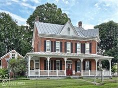 BEAUTIFUL! All brick colonial built in 1902 that boasts a wrap around porch, summer kitchen with original oven, small log cottage, gazebo and 3 car garage. Open the doors and step back in time. Historic charm!