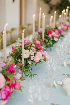 destination wedding tablescape filled with hot pink florals and taper candles | Photography: Jemma Keech