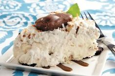 Mounds of Joy Whipped Pie -  1 pkg. (8 oz.) PHILADELPHIA Cream Cheese, softened 1 cup cream of coconut, pkg. (3.9 oz.) JELL-O Cheesecake Flavor Instant Pudding, 4oz. frozen sweetened flaked coconut, divide in 1/2 and toasted, 1 (8 oz. each) COOL WHIP Whipped Topping, divided, 1 OREO Pie Crust Hard-shell chocolate ice cream topping (optional), 6 mini chocolate-coated coconut and almond candy bars