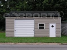 This small garage with side entry is used for storage. It features a boxed eave style roof and garage door on the front side.