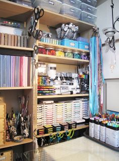 studio work desk colour & media shelf by melstampz, via Flickr - like the way she hangs tools from the shelves