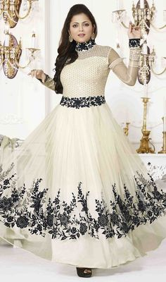 Look gorgeous like as Drashti Dhami, owning this off white color embroidered net Anarkali dress. The interesting patch, resham and stones work a significant attribute of this dress.  #BollywoodActressAnarkaliSuitDesign