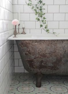 Old textures combined with clean new tiles can make the perfect bathroom design. This is an easy bathroom DIY that anyone can create in their home.