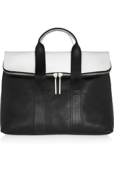 3.1 Phillip Lim 31 Hour two-tone leather tote.  Gorgeous; I prefer the white-and-black to the black-and-tan.  Also, worth more than a plane ticket to Hawaii T^T