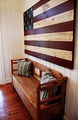 Rustic decor in the entry way of an Isle of Palms cottage.....but for me it would be a Texas flag :)
