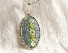 hand embroidered necklace by skrynka (http://www.etsy.com/listing/90274280/hand-embroidered-necklace-line-of)