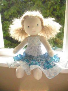 waldorf doll in pretty blue dress