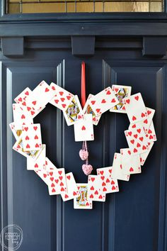 This DIY Valentine's Day wreath couldn't be any easier (or cheaper) to make. Two decks of playing cards and some foam board are all you need to create it!