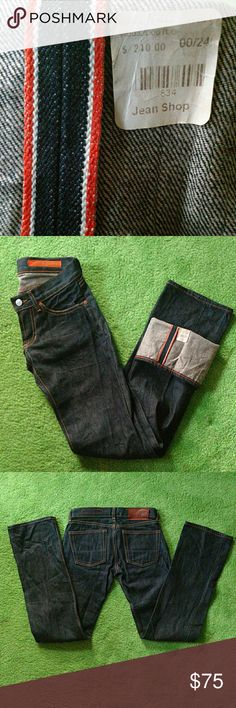 Jean Shop Raw Denim/ Selvedge Classic Fit size 00 -Nice Jean Shop woman's Raw Denim in medium classic fit. -Dark blue Selvedge Denim color in size 00/24 -Made in the USA.  -100% leather back patch -Work wear inspired  One of the original tags is still on these. Never been washed. Look like they have never even been worn!  Thank you for shopping! : ) Jean Shop Jeans Straight Leg