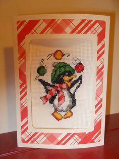 Juggling Penquin Christmas Card Cross Stitched by RomanceWriter