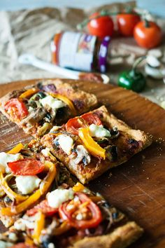 firey veggie pizza with harissa, lemon + feta