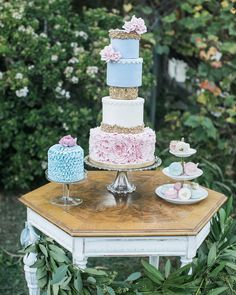 Tiers upon tiers of sweet beauty! (As featured on @weddingchicks - - Vintage Rentals: @sweetsalvagerentals | Venue: @bheau_view_ranch_weddings | Photographer sweeet bloom photography | Florals: @theflowerstoryco | Wedding Planner & Designer @rusticvintageevents | Cake @littlehunnyscakery | Macarones @pennyscustomcookies | Gown @archivebridalcarlsbad | Tux @friartux | Makeup and hair @naomim_hair_makeup | Model @ellienikolesuccar)