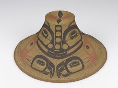 BASKETRY HAT NORTH AMERICAN ETHNOGRAPHIC COLLECTION Catalog No: 16 / 692 Locale: BC Country: CANADA Material: PLANT FIBER, PIGMENT, CLOTH, THREAD Dimensions: D:37.5 H:17.5 [in CM] Acquisition Year: 1869-1890 [GIFT] Donor: BISHOP, HEBER R. Artist: EDENSHAW Keywords: BASKETRY HAT