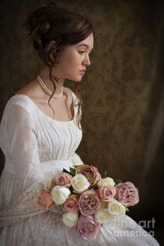 Woman In Regency Period Dress Holding A Bunch Of Roses Photograph