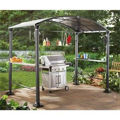 Eclipse Backyard Grill Center, Black • BBQ rain or shine! • Sturdy aluminum frame and columns • 6 hanging hooks and a central hanging rack • Bases of columns accept ground stakes • Grill not included Awning Gazebo, Grill Gazebo, Awning Canopy, Backyard Gazebo, Backyard Ideas, Patio Ideas, Pergola, Ideas De Barbacoa, Gardens