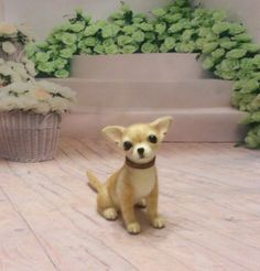 This Chihuahua is firmly needle felted entirely with 100% natural wool. She measures about 2.5 inches(11 cm) wide and 5.25 inches (13.5 cm) high. The