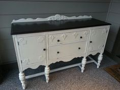 Antique sideboard refinished in antique white and kona stain.