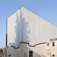 French architects Opus 5 have built a concert hall on top of a former seventeenth century convent in northern Franc