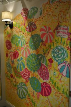 This dressing room was designed with walls painted with beach umbrellas.