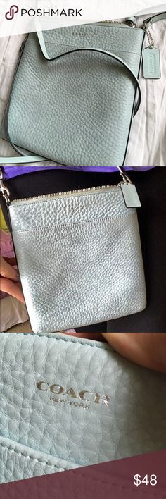 Coach Leather Crossbody Purse This is an adorable light blue leather Crossbody Purse by Coach. This Purse has barely been used and is in wonderful condition! It really is like new. There are no signs of wear and tear on this purse. Coach Bags Crossbody Bags