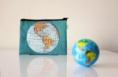 World Map zipper pouch printed with an old map of the by efratul