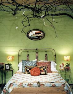 vibrant sage green cement brick wall bohemian branch twig sculpture vintage painted metal frame bed