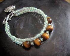 Tiger eye bracelet with Czech crystals and sun charm. / by eendar, €8.80