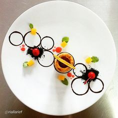 """#finestfood #finedining #food #foodporn #gourmet #instagramfood #chef #foodart #lovefood #bestplating #instafood #yummy #foodpic #photooftheday #instagourmet #dinner #lunch #dessert #instacool #taste #art #goodeats #gastronomy #love #luxury #cook #cooking #foodgasm #instagood  By @riallarief """"Patty Shell Vanilla Vla, Choco Crumb Fresh Cherry, Strawberry Sauce and Diced Peach."""""""