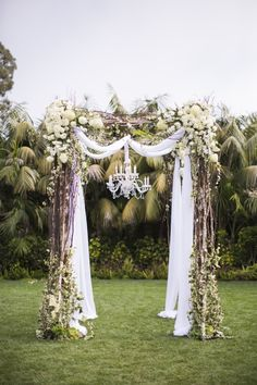Awash in hues of cream and white, this garden wedding has us smitten with its vintage charm. From paper heart garlands and marmalade favors to a dazzling wedding arch with a sparkly chandelier, it's full of sweet surprises thanks to