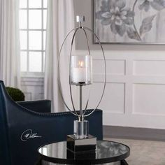 Modern Hurricane on Crystal and Metal Pedestal Base in Silver Finish Polished Silver With Crystal Accents And A Clear Glass Globe With Air Bubbles Seeded Throughout. Distressed White Candle Included.Modern Hurricane on Crystal and Metal Pedestal Base in Silver Finish