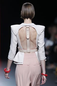 Open back jacket with structured silhouette and belted strap back harness detail; alternative tailoring; close up fashion details