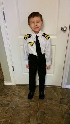Black and yellow felt, cut into the shapes then used fabric glue to glue the tie, badge, and shoulder insignia onto the shirt. Career Costumes, Dress Up Costumes, Diy Costumes, Pilot Costumes, Costume Ideas, Halloween Costumes For Kids, Halloween Diy, Halloween Dress, Happy Halloween