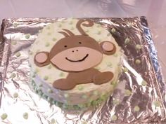 Baby Shower cake. Banana cake with cream cheese frosting and monkey made out of marshmallow fondant.