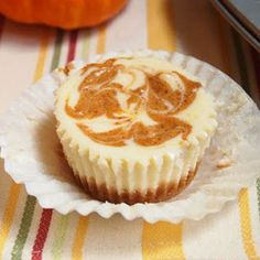 Pumpkin Swirl Cheesecake Cupcakes    Print Ingredients For the CRUST: 7 graham cracker sheets (or equivalent in gingersnaps) ½ tsp ground ci...