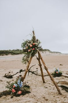 Ceremony Backdrop Drift Wood Branch Tipi Flowers Beautiful Bohemian Beach Glamping Wedding http://www.thecurries.co/