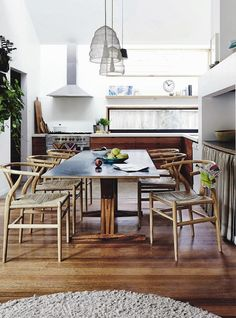 Make a statement in your dining room with some Hans Wegner Wishbone chair's. #Classic