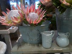 Pale pink King Proteas in grey metal buckets always look gorgeous, pictured here in The Rose Cafe, www.therosecafe.co.za