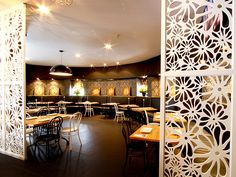 Interior spaces of thai restaurants | white floral screens to divide up the space in the restaurant ...
